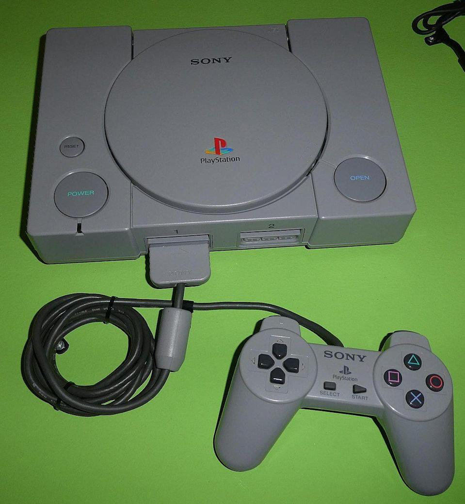 "<p>Sony Computer Entertainment debuted the PlayStation, alongside a drastically different gamepad. The original form factor included a directional pad, a ""start"" and ""select"" button, and four face buttons with a green triangle, blue cross, red circle, and pink square. It also included shoulder buttons on top of the controller, which were used for additional functionality. The face button shapes would become synonymous with the system throughout the PlayStation's future iterations. </p>"