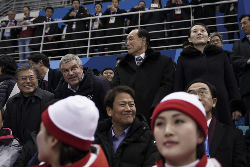 Kim Yo Jong, sister of North Korean leader Kim Jong Un, standing right, and North Korea's nominal head of state Kim Yong Nam, second right, join Thomas Bach, President of the International Olympic Committee, at a women's hockey game between Switzerland and the combined Koreas at the 2018 Winter Olympics. (AP)