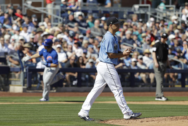 Seattle Mariners' Marco Gonzales walks back to the mound after giving up a three-run home run to Chicago Cubs' Josh Phegley during the first inning of a spring training baseball game, Monday, Feb. 24, 2020, in Peoria, Ariz. (AP Photo/Darron Cummings)