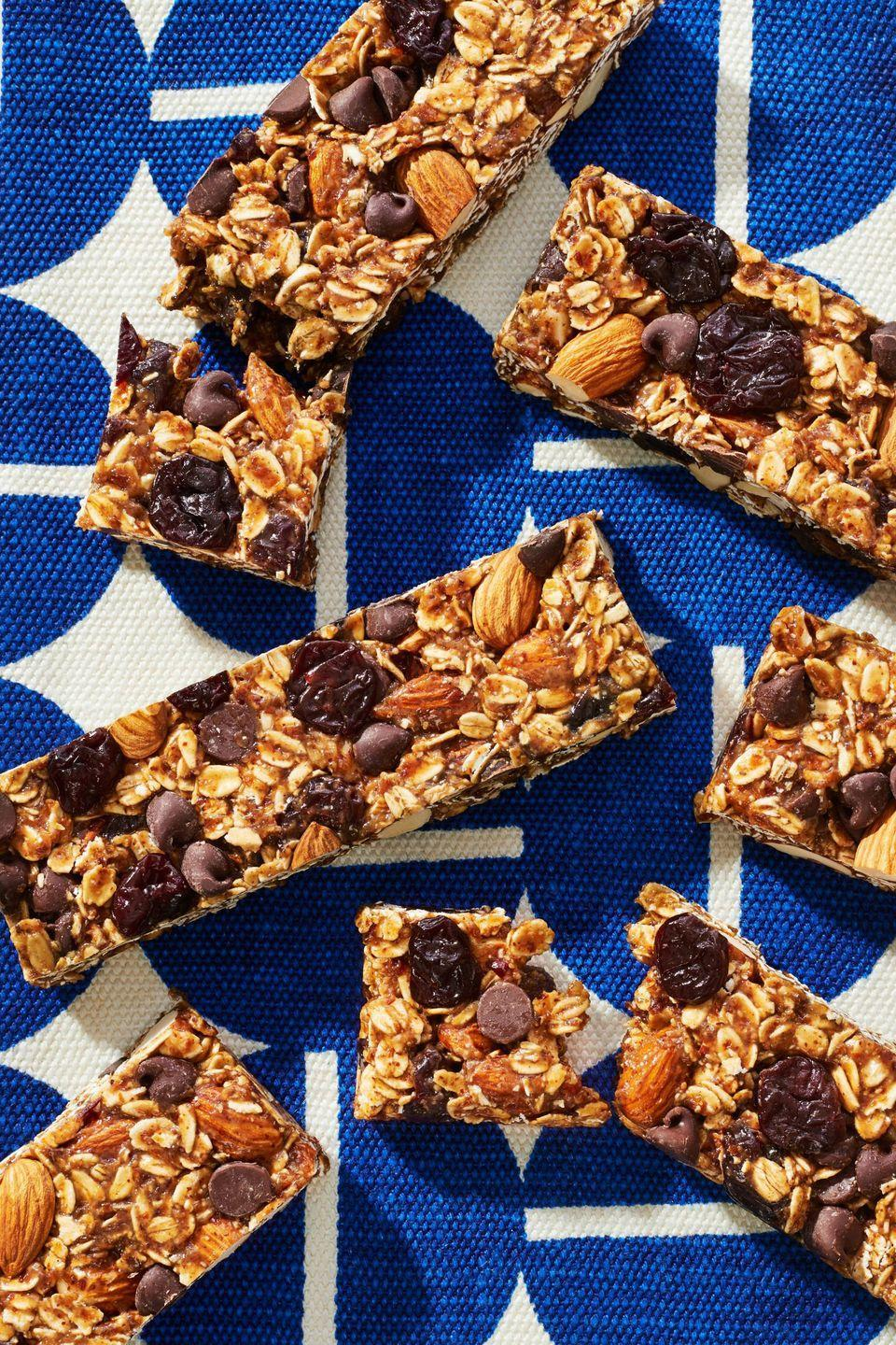 "<p>Store-bought granola bars are packed with sugar, so making your own cuts back on unnecessary ingredients and ensures they have something healthy to eat on-the-go.</p><p><em>Get the recipe at </em><em><a href=""https://www.redbookmag.com/food-recipes/advice/g2267/make-ahead-breakfasts/?slide=3"" rel=""nofollow noopener"" target=""_blank"" data-ylk=""slk:Redbook."" class=""link rapid-noclick-resp"">Redbook.</a></em></p>"