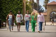 <p>Between the takes on denim, collegiate sweatshirts, and a pop of bright color, the whole crew is casual-cool at their college reunion. </p>