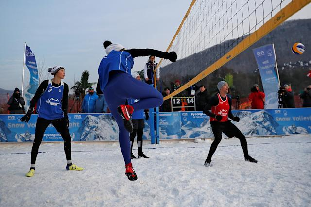 Pyeongchang 2018 Winter Olympics - Pyeongchang - South Korea – February 14, 2018. Xue Chen of China returns the ball during an event promoting the Snow Volleyball hosted by the International Volleyball Federation (FIVB) and European Volleyball Confederation (CEV). REUTERS/Kim Hong-Ji