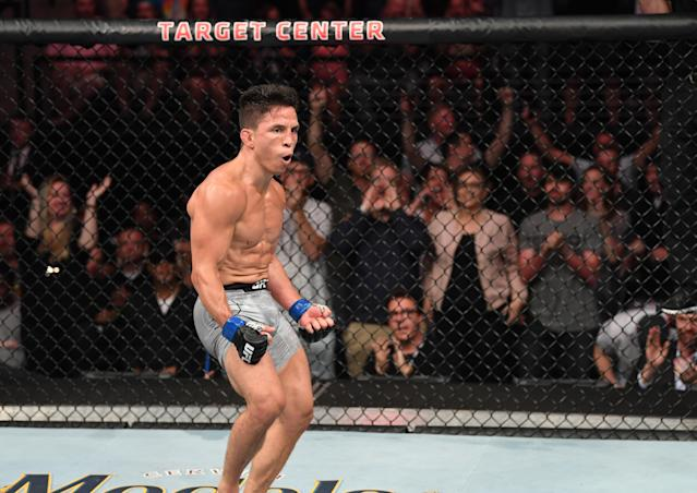 Joseph Benavidez and Deiveson Figueirdo will step into the octagon in February with the 125-pound flyweight title on the line. (Josh Hedges/Zuffa LLC/Getty Images)