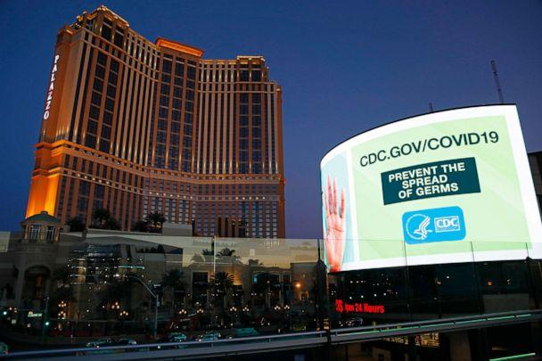 PHOTO: A sign advises people to minimized the spread of germs, along the Las Vegas Strip devoid of the usual crowds during the coronavirus outbreak, May 26, 2020, in Las Vegas. (John Locher/AP)
