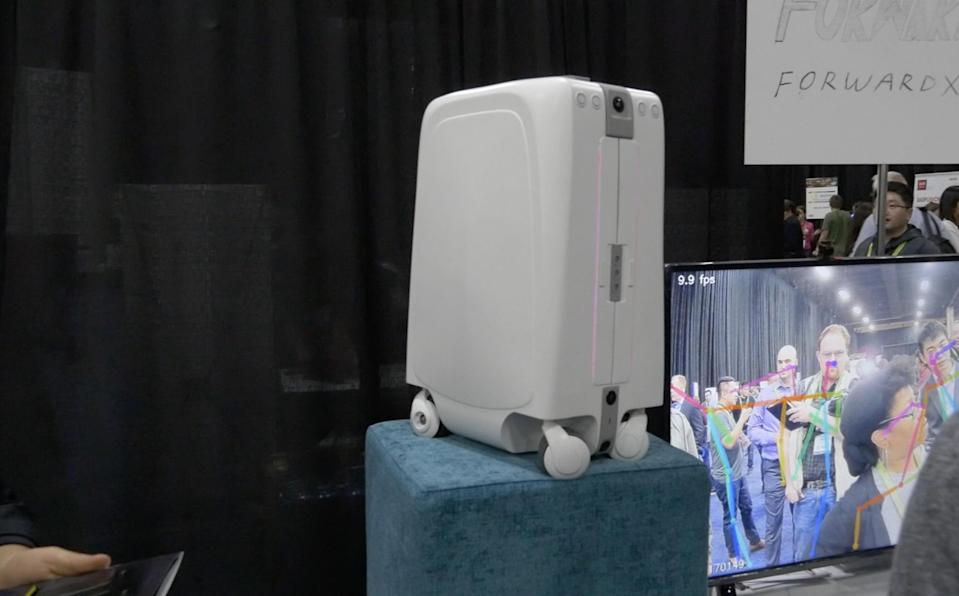 <p>This 'smart suitcase' feels incredibly futuristic – it follows its owner through the airport on its own motorised wheels, using facial recognition and a controller wristband worn by its owner. </p>