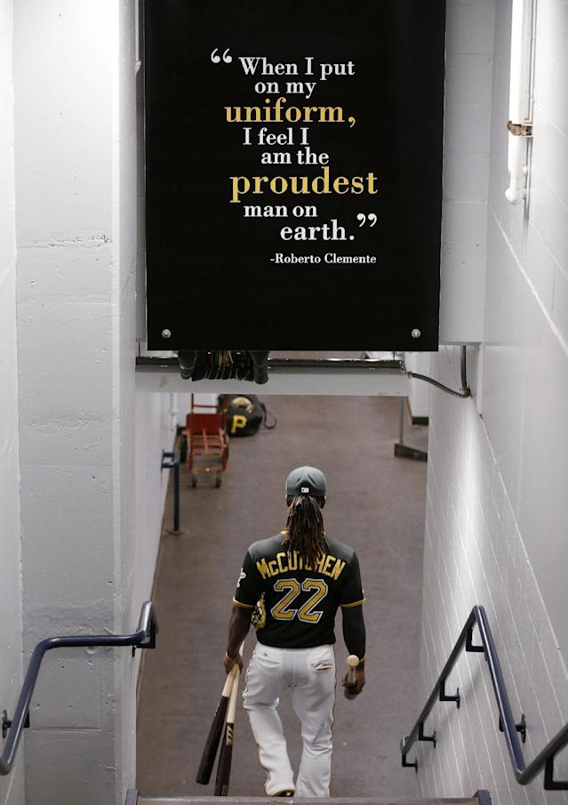 Pittsburgh Pirates' Andrew McCutchen (22) walks to the field before the National League wild-card playoff baseball game against the Cincinnati Reds in Pittsburgh on Tuesday, Oct. 1, 2013. (AP Photo/Gene J. Puskar)