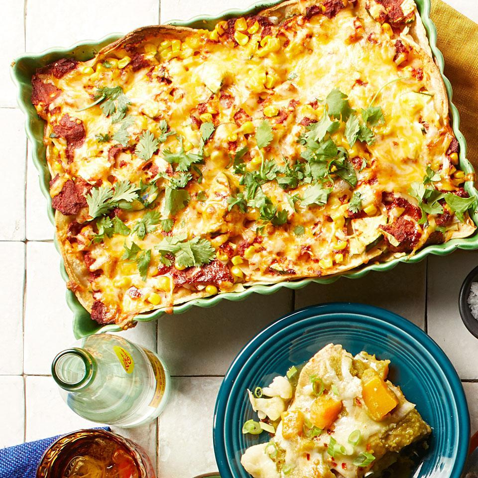 """<p>Skip rolling and just layer these quick and easy enchiladas. This recipe uses a quick blender sauce, but if you're short on time, pick up a can of your favorite red enchilada sauce in the international aisle of your grocery store--you'll need about 3 cups. <a href=""""http://www.eatingwell.com/recipe/268705/zucchini-corn-enchiladas/"""" rel=""""nofollow noopener"""" target=""""_blank"""" data-ylk=""""slk:View recipe"""" class=""""link rapid-noclick-resp""""> View recipe </a></p>"""