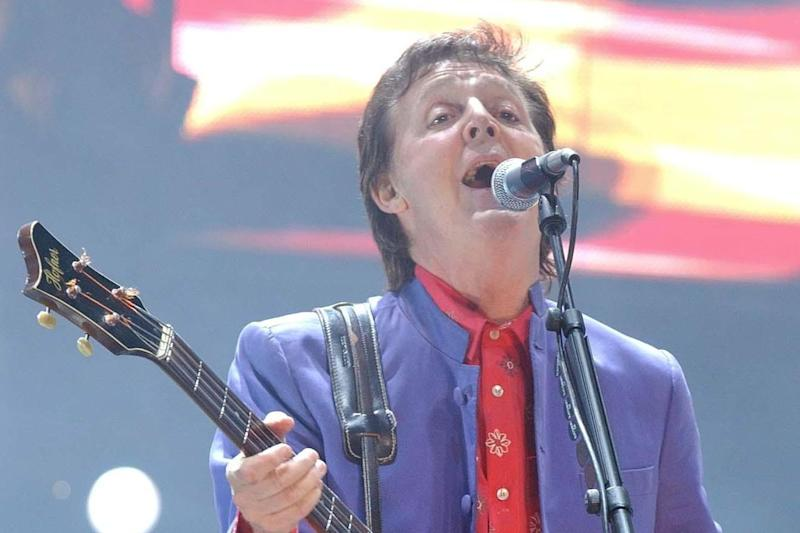 Sir Paul will play at the festival next year (PA Archive/PA Images)