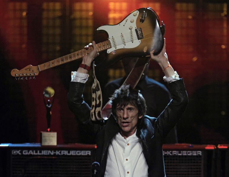 Ronnie Wood celebrates after the finale of the 2012 Rock and Roll Hall of Fame inductions Sunday, April 15, 2012, in Cleveland. The Rolling Stones guitarist was inducted for his earlier work with the Faces. (AP Photo/Tony Dejak)