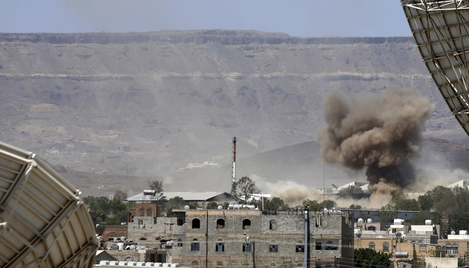FILE - In this Sept. 9, 2015 file photo, smoke rises after an airstrike by the Saudi-led coalition on an army base in Sanaa, Yemen. Yemen's war began in September 2014, when the Houthis seized the capital Sanaa. Saudi Arabia, along with the United Arab Emirates and other countries, entered the war alongside Yemen's internationally recognized government in March 2015. The war has killed some 130,000 people and driven the Arab world's poorest country to the brink of famine. (AP Photo/Hani Mohammed)