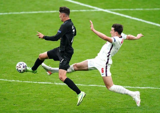 Germany's Kai Havertz (left) and England's Harry Maguire battle for the ball