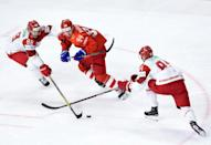 The Belarus team, playing in white here against Russia in 2018, will be at the world championships even though they lost the right to co-host with Latvia