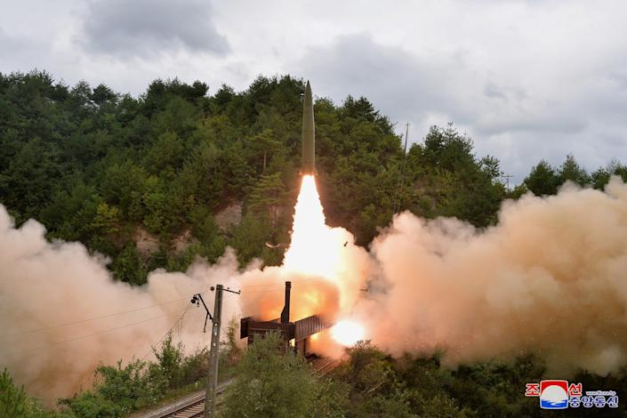 A missile is seen launched during a drill of the Railway Mobile Missile Regiment in North Korea