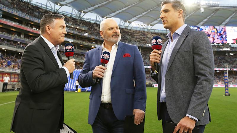 Jason Dunstall, pictured here in commentary before an AFL match.