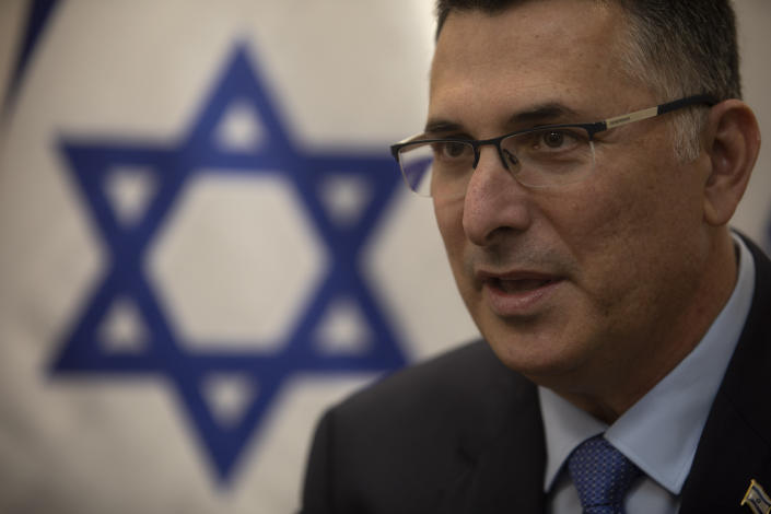 """Israeli politician Gideon Saar speaks at the party headquarters in Tel Aviv, Israel, Thursday, Jan. 14, 2021. Saar is promising """"new hope"""" for voters ahead of March elections, and a different approach to relations with the United States after the four-year lovefest between Prime Minister Benjamin Netanyahu and President Donald Trump. (AP Photo/Sebastian Scheiner)"""