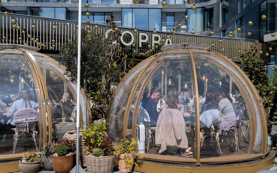 The need for social distancing has led some restaurants to open 'dining bubbles', like this one at Coppa Club London - Getty