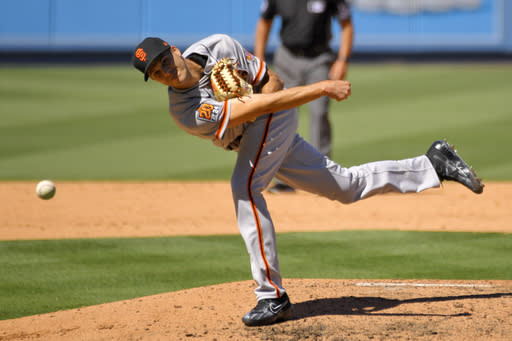 San Francisco Giants relief pitcher Tyler Rogers throws to the plate during the seventh inning of a baseball game against the Los Angeles Dodgers Sunday, Aug. 9, 2020, in Los Angeles. (AP Photo/Mark J. Terrill)