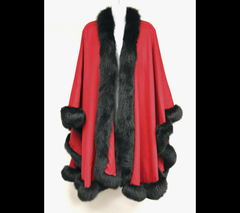 This undated photo provided by Texas-based Gaston & Sheehan Auctioneers, Inc. shows a red cashmere cape with black mink trim that once belonged to former Illinois Congressman Jesse Jackson Jr. and his wife, Sandi. It is among the items U.S. Marshals Service started selling in an online auction Tuesday, Sept. 17, 2013, in its attempt to recoup part of the $750,000 in campaign funds the Chicago Democrat and his wife illegally spent. Both were handed prison terms last month. The auction runs through Sept. 26. (AP Photo/Courtesy Gaston & Sheehan Auctioneers, Inc.)