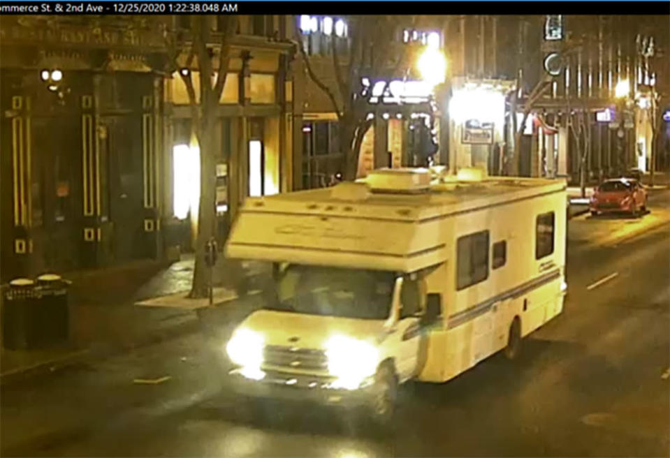 This image taken from surveillance video provided by Metro Nashville PD shows a recreational vehicle that was involved in a blast on Friday, Dec. 25, 2020 in Nashville, Tenn. An explosion shook the largely deserted streets early Christmas morning, shattering windows, damaging buildings and wounding some people. Police were responding to a report of shots fired when they encountered a recreational vehicle blaring a recording that said a bomb would detonate in 15 minutes, Metro Nashville Police Chief John Drake said. Police evacuated nearby buildings and called in the bomb squad. (Metro Nashville PD via AP)