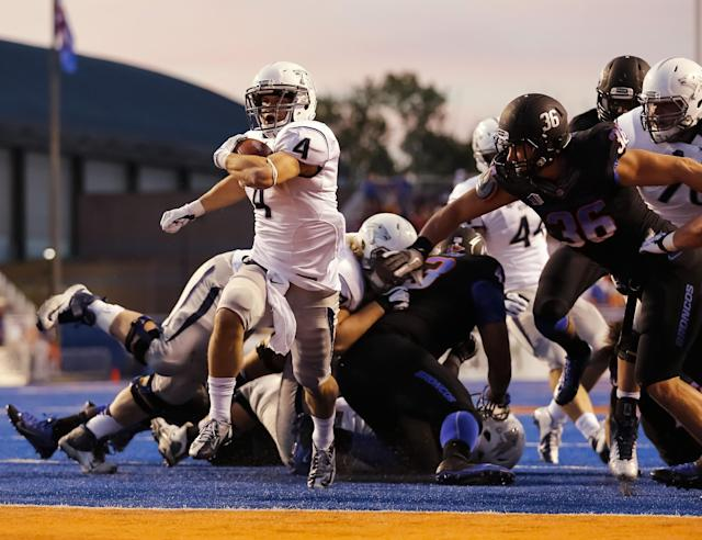 Nevada running back Kendall Brock (4) scores a touchdown during the first half of an NCAA college football game against Boise State in Boise, Idaho, Saturday, Oct. 19, 2013. (AP Photo/Otto Kitsinger)
