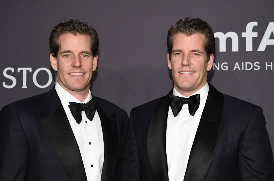 Cameron Winklevoss, left, and Tyler Winklevoss attend amfAR's Fashion Week New York Gala at Cipriani Wall Street on Wednesday, Feb. 8, 2017, in New York. (Photo by Evan Agostini/Invision/AP)