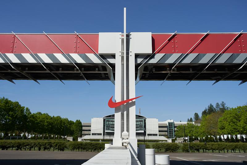 "Beaverton, Oregon, USA - Apr 24, 2019: The Nike ""Swoosh"" logo at one of the entrances to Nike World Headquarters."