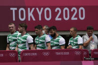 The Irish team walks off the pitch after being defeated by South Africa in their men's rugby sevens match at the 2020 Summer Olympics, Monday, July 26, 2021 in Tokyo, Japan. (AP Photo/Shuji Kajiyama)