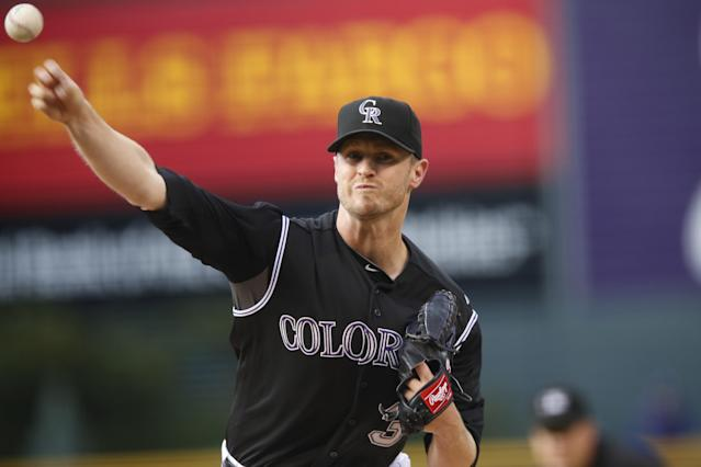 Colorado Rockies starting pitcher Kyle Kendrick works against the Texas Rangers in the first inning of an inter league baseball game Tuesday, July 21, 2015, in Denver. (AP Photo/David Zalubowski)