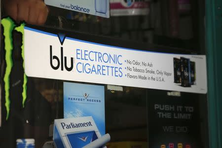 Advertisement for the e-cigarette brand blu is seen on window of a store in New York