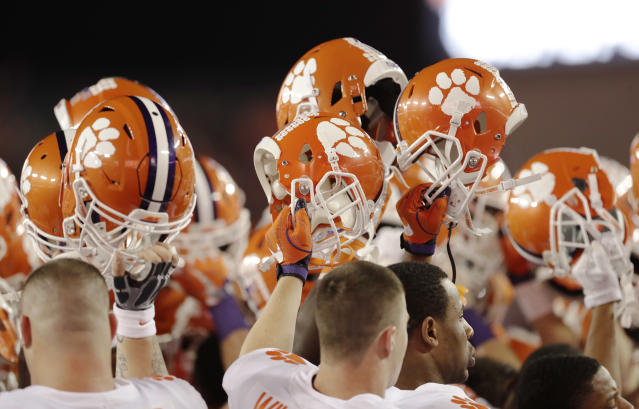 Clemson players hold up their helmets before the NCAA college football playoff championship game against Alabama Monday, Jan. 9, 2017, in Tampa, Fla. (AP Photo/Chris O'Meara)