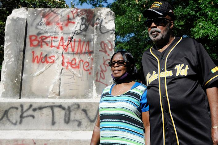 Sarah Collins Rudolph, who survived a racist church bombing that killed sister Addie Mae Collins and three other girls in 1963, stands with husband George Rudolph at the remains of a Confederate memorial that was removed in Birmingham on June 2.