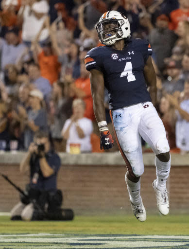 Auburn wide receiver/defensive back Noah Igbinoghene (4) celebrates a 96-yard touchdown on a kickoff return during the second half of an NCAA college football game, Saturday, Sept. 22, 2018, in Auburn, Ala. (AP Photo/Vasha Hunt)