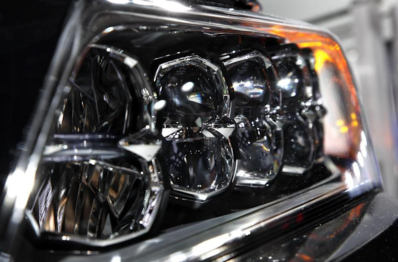 A headlight on the 2014 Acura RLX is shown at media previews for the North American International Auto Show in Detroit, Tuesday, Jan. 15, 2013.  (AP Photo/Paul Sancya)