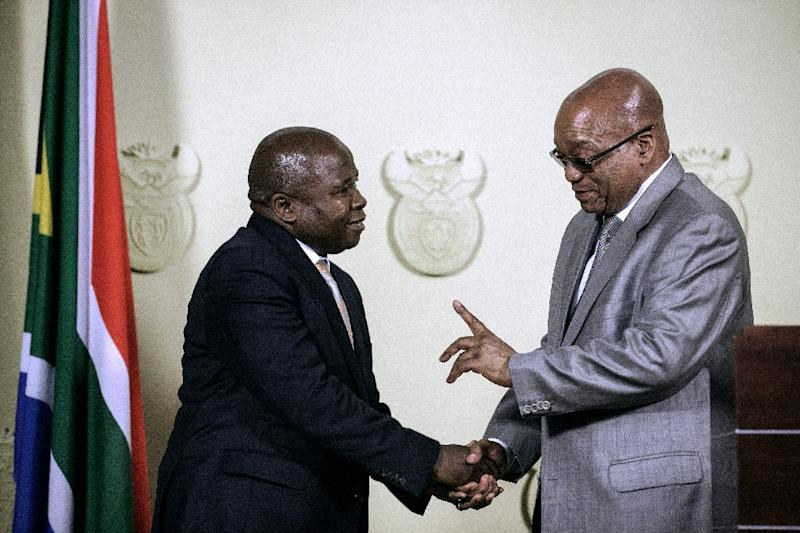 South African president Jacob Zuma (R) swore in legislator David Van Rooyen (L) as his new finance minister on December 10, 2015 -- only to dismiss him late in the evening of Sunday, December 13 after markets balked and the national currency crashed