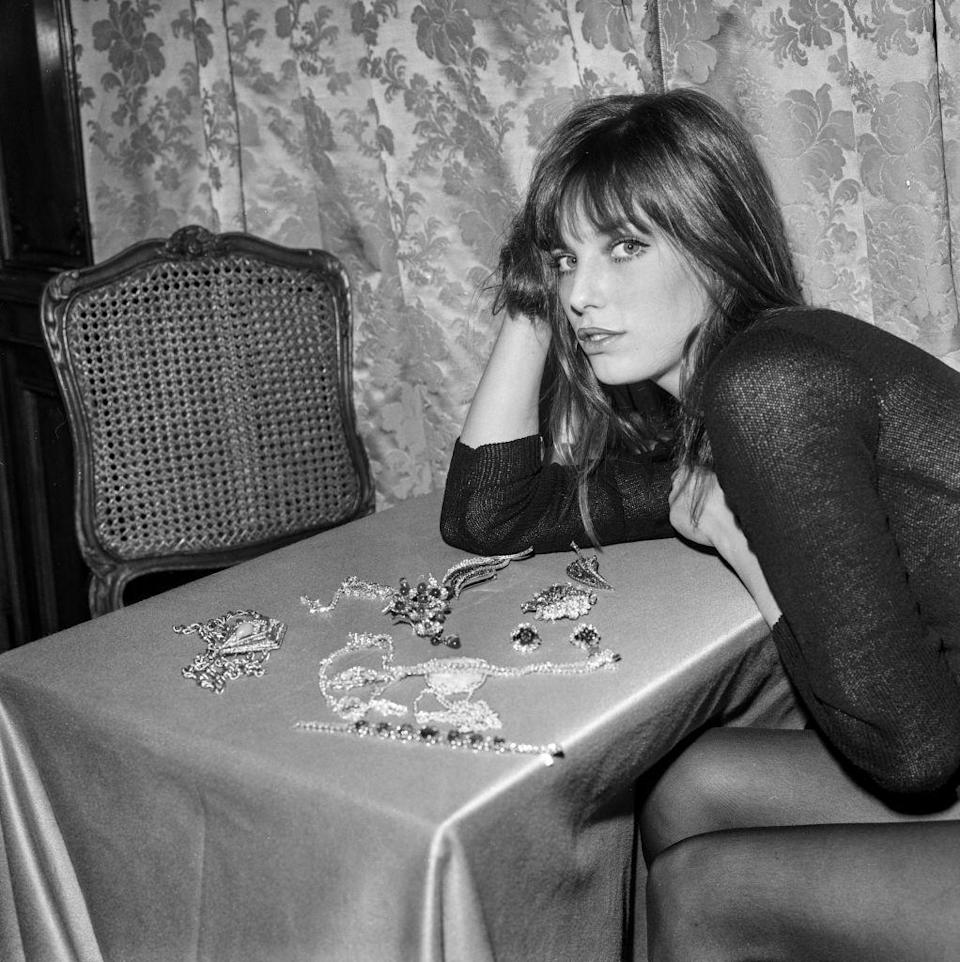 <p>Diamonds are a girl's best friend—including Jane Birkin's. The performer has a table full of accessories from famed jeweler, Boucheron, to choose from at an exhibition in 1969.</p>