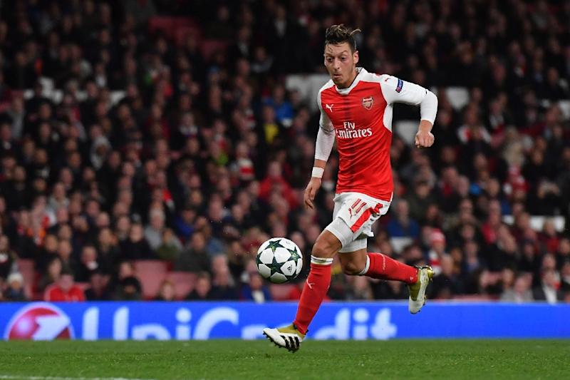 Arsenal's midfielder Mesut Ozil shoots to score his hat trick, and his teams sixth goal, during the UEFA Champions League Group A football match between Arsenal and Ludogorets Razgrad at The Emirates Stadium in London on October 19, 2016 (AFP Photo/Ben Stansall)