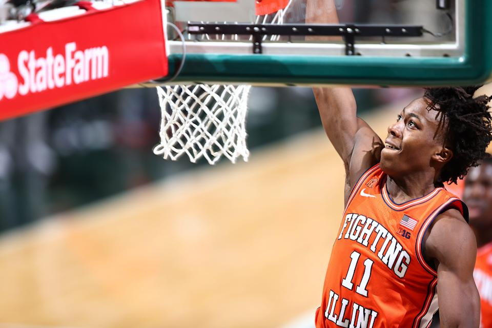 Ayo Dosunmu of the Illinois Fighting Illini dunks the ball during the game against the Michigan State Spartans.