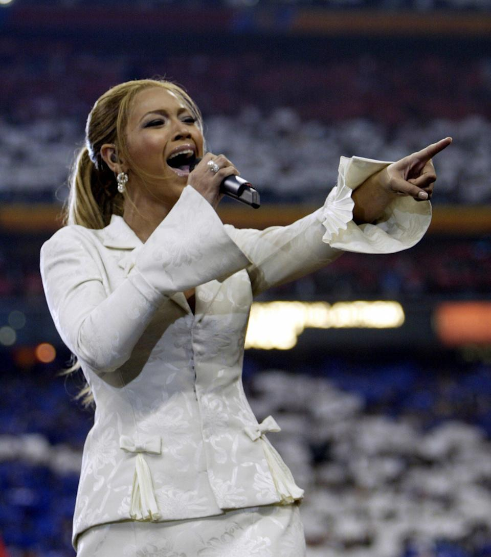 Singer Beyonce performs the US national anthem at Super Bowl XXXVIII at Reliant Stadium onFeb.1, 2004in Houston, Texas.