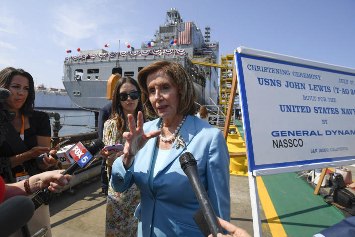 Speaker of the House Nancy Pelosi talks to the media in front of USNS John Lewis after a christening ceremony Saturday July 17, 2021, in San Diego. (AP Photo/Denis Poroy)
