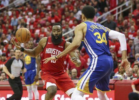 May 6, 2019; Houston, TX, USA; Houston Rockets guard James Harden (13) attempts to control the ball as Golden State Warriors guard Shaun Livingston (34) defends during the fourth quarter in game four of the second round of the 2019 NBA Playoffs at Toyota Center. Mandatory Credit: Troy Taormina-USA TODAY Sports