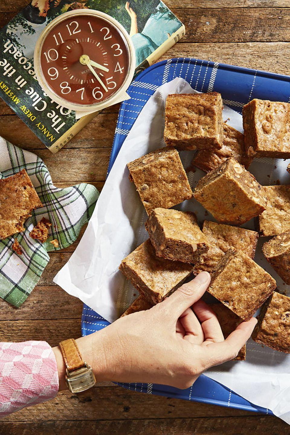 """<p>Inspired by Nancy Drew, these brown sugar and chopped hazelnuts blondies are the perfect fuel for a <a href=""""https://www.countryliving.com/entertaining/g4790/nancy-drew-themed-halloween-mystery-party/"""" rel=""""nofollow noopener"""" target=""""_blank"""" data-ylk=""""slk:murder mystery party"""" class=""""link rapid-noclick-resp"""">murder mystery party</a>.</p><p><strong><a href=""""https://www.countryliving.com/food-drinks/recipes/a44613/brown-butter-hazelnut-blondies-recipe/"""" rel=""""nofollow noopener"""" target=""""_blank"""" data-ylk=""""slk:Get the recipe"""" class=""""link rapid-noclick-resp"""">Get the recipe</a>.</strong><br></p>"""