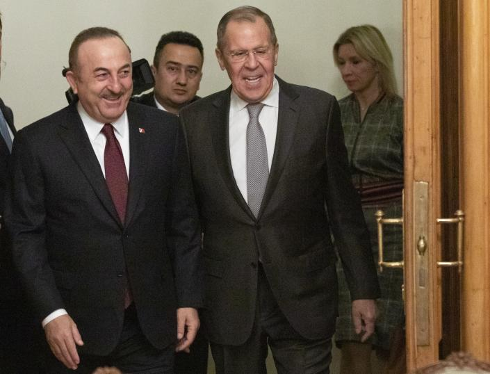 Turkish Foreign Minister Mevlut Cavusoglu, left, and Russian Foreign Minister Sergey Lavrov enter a hall for the talks in Moscow, Russia, Monday, Jan. 13, 2020.Foreign and defense ministers of Russia and Turkey met as part of an effort by Moscow and Ankara to sponsor Monday's talks between rival parties in Libya in the Russian capital. (AP Photo/Pavel Golovkin, Pool)