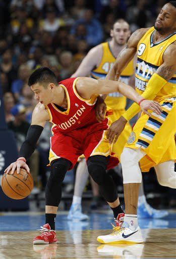 Houston Rockets guard Jeremy Lin, left, picks up a loose ball as Denver Nuggets guard Andre Iguodala cover in the third quarter of an NBA basketball game in Denver on Saturday, April 6, 2013. (AP Photo/David Zalubowski)