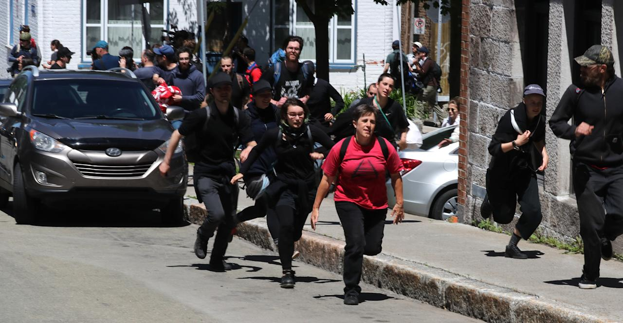 <p>Protesters run from riot police during the G7 Summit in Quebec City, Quebec, Canada, June 8, 2018. (Photo: Jonathan Ernst/Reuters) </p>