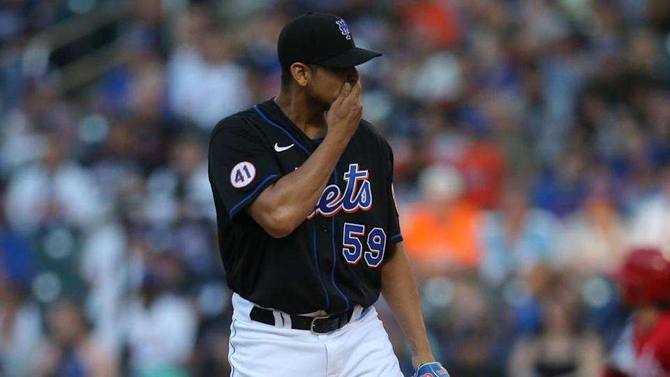 Jul 30, 2021; New York City, New York, USA; New York Mets starting pitcher Carlos Carrasco (59) reacts after giving up a solo home run to Cincinnati Reds second baseman Jonathan India (6) during the first inning at Citi Field.