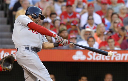 St. Louis Cardinals' Daniel Descalso breaks his bat as he hits an RBI double during the second inning of the Cardinals' baseball game against the Los Angeles Angels, Wednesday, July 3, 2013, in Anaheim, Calif. (AP Photo/Mark J. Terrill)