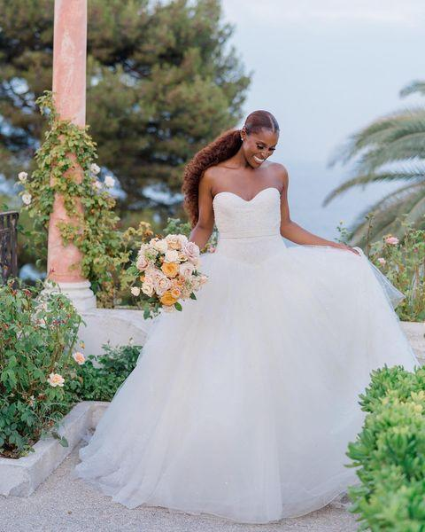 """<p><a href=""""https://www.elle.com/uk/life-and-culture/culture/news/a39083/issa-rae-definition-white-privilege-insecure/"""" rel=""""nofollow noopener"""" target=""""_blank"""" data-ylk=""""slk:The Insecure actress"""" class=""""link rapid-noclick-resp"""">The Insecure actress</a> tied the knot with businessman Diame in the south of France wearing a stunning custom strapless, princess-style tulle wedding gown by Vera Wang. The dress also came with a beautiful tulle veil which was placed over Rae's ponytail.</p><p>The groom opted to break with tradition, wearing a red velvet tuxedo for the picturesque nuptials.<br></p><p><a href=""""https://www.instagram.com/p/CRynCd3MqRI/"""" rel=""""nofollow noopener"""" target=""""_blank"""" data-ylk=""""slk:See the original post on Instagram"""" class=""""link rapid-noclick-resp"""">See the original post on Instagram</a></p>"""