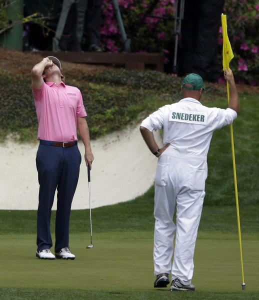 Brandt Snedeker reacts after missing a putt on the 12th green during the fourth round of the Masters golf tournament Sunday, April 14, 2013, in Augusta, Ga. (AP Photo/David Goldman)
