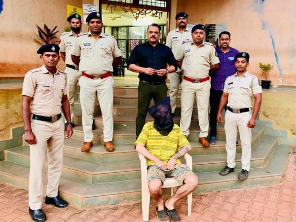 Goa police with the arrested Russian national on Tuesday. (Photo/ANI)