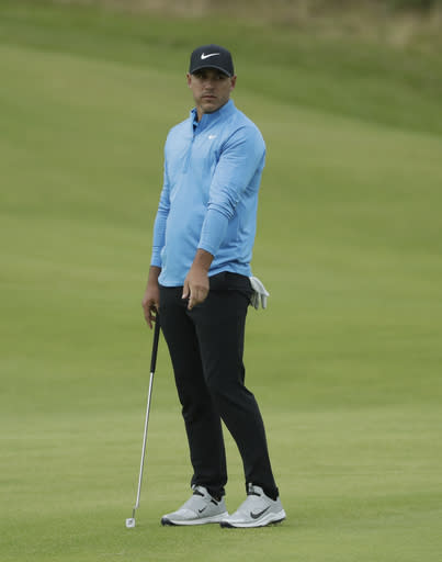 Brooks Koepka of the United States rues a missed putt on the 17th green during the third round of the British Open Golf Championships at Royal Portrush in Northern Ireland, Saturday, July 20, 2019.(AP Photo/Matt Dunham)